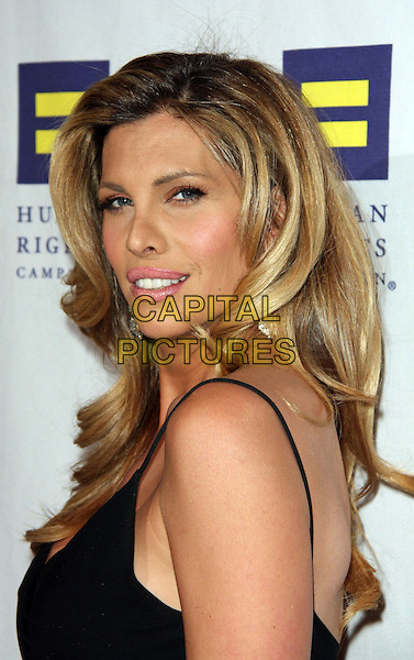 CANDIS CAYNE .The Human Rights Campaign's Annual Los Angeles Gala & Hero Awards held at the Hyatt Regency Plaza Hotel, Century City, California, USA, .14th March 2009..portrait headshot back over shoulder .CAP/ADM/KB.©Kevan Brooks/Admedia/Capital PIctures