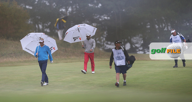 Players turn to umbrellas as the weather turns during Round Two at the KLM Dutch Open, from the Kennemer Golf & Country Club, Zandvoort, Netherlands. Picture:  David Lloyd / www.golffile.ie