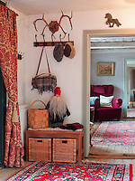The stool in the hall is made by Bo Stridsby, while the bark basket on top is Finnish handicraft