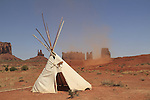 Dust storm and Native American teepee tent, Navajo Indian Reservation, Arizona, USA. . John offers private photo tours in Monument Valley and throughout Arizona, Utah and Colorado. Year-round.