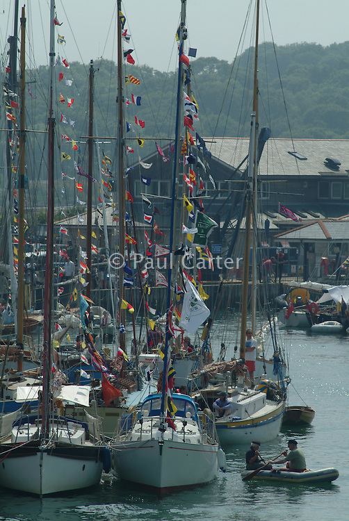 Yachts in a harbour dressed in bunting Yarmouth Harbour , Isle of Wight , UK