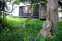 A small statue and out-building at Brown's Field, Isumi, Chiba Prefecture, Japan, August 9, 2009.The organic farm introduces healthy and sustainable living in the Japanese countryside. It is staffed by the Brown family and volunteers from around the world.