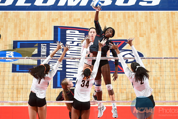 COLUMBUS, OH - DECEMBER 17:  Inky Ajanaku (12) of Stanford University spikes the ball against the University of Texas during the Division I Women's Volleyball Championship held at Nationwide Arena on December 17, 2016 in Columbus, Ohio.  Stanford defeated Texas 3-1 to win the national title. (Photo by Jamie Schwaberow/NCAA Photos via Getty Images)