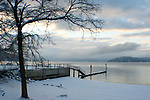 Retaining wall and dock on the North Idaho College beach of Lake Coeur D Alene on a snowy December dawn.