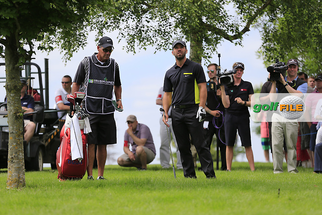 Paul Casey (ENG) waits to play his 2nd shot from the rough on the 9th hole during Friday's Round 2 of the 2014 Irish Open held at Fota Island Resort, Cork, Ireland. 20th June 2014.<br /> Picture: Eoin Clarke www.golffile.ie