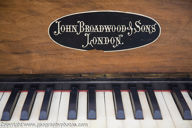Close up of old piano keys made by John Broadwood and Sons, London, England
