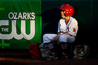 The Springfield Cardinals Bat Boy sits in the setting sun during a game against the Tulsa Drillers at Hammons Field on July 19, 2011 in Springfield, Missouri. Tulsa defeated Springfield 17-11. (David Welker / Four Seam Images)