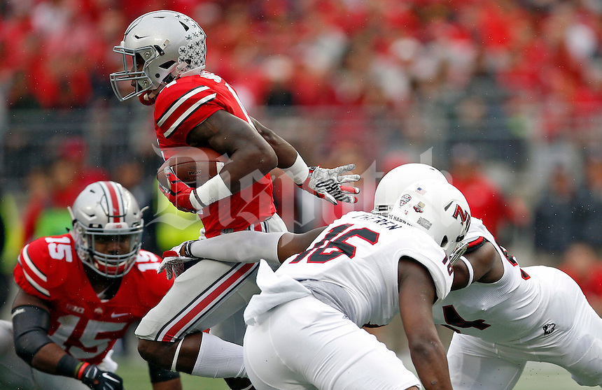 Ohio State Buckeyes running back Curtis Samuel (4) gets past Northern Illinois Huskies linebacker Renard Cheren (16) during the 1st quarter of their game at Ohio Stadium on September 19, 2015.  (Dispatch photo by Kyle Robertson)