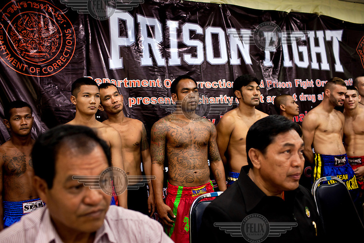 Mauy Thai fighters at a press conference at Khlong Phai Prison for 'Prison Fight', an event where a series of fights are held between prisoners and Western fighters. Mauy Thai has a long association with prisons and prisoners. Even its origin myths involve the incarcerated. It is said that in 1774 the Burmese king Hsinbyushin organised a series of fights between Thai prisoners, taken during the conquest of the Siamese capital of Ayutthaya seven years earlier, and Burmese champions. More recently the Thai prison system has embraced Mauy Thai as a form of rehabilitation. In 2012 an Estonian entrepreneur arranged bouts between Thai prisoners and Western Mauy Thai fighters under the banner 'Prison Fight'. For the prisoners a victory held the potential of time off their sentence. While the western fighters fought for a small purse and personal ambition.