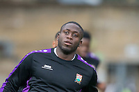 John Akinde of Barnet warms up during the Sky Bet League 2 match between Wycombe Wanderers and Barnet at Adams Park, High Wycombe, England on 22 October 2016. Photo by Kevin Prescod.
