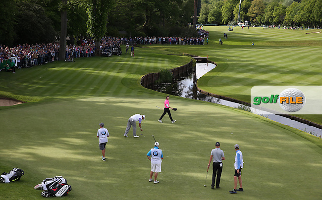 Tommy Fleetwood (ENG) sinks a long putt on the last during Round Two of the 2015 BMW PGA Championship over the West Course at Wentworth, Virginia Water, London. 22/05/2015Picture David Lloyd, www.golffile.ie.