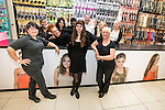 © Joel Goodman - 07973 332324 . 15 August 2013 . Paul's Hair World , Arndale Centre, Manchester , UK . The team are L-R: Amanda Wrench , Kimmy Thomas , Kristy Humphries , Josie Humphries (no relation to Kristy) , Kayann Wright , Gemma Leach , Paul Barnett , Lyndsay Purcell , Hayley Smith , Agnes Bardsley and Nikki Purcell (who IS related to Lyndsay) (all correct) . Newly reopened retail outlet for Pauls Hair World . The original outlet on Oldham Street was destroyed in a fire on 13th July 2013 . The fire claimed the life of firefighter Stephen Hunt . Photo credit : Joel Goodman