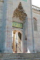 An ornately carved archway forms the entrance to the rear courtyards at the Blue Mosque, Istanbul