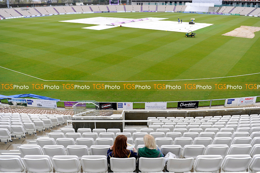 Lone spectators wait for the covers to come off-Hampshire CCC vs Worcestershire CCC - LV County  Championship Cricket Match at the Ageas Bowl, Hampshire - 06/04/14 - MANDATORY CREDIT: Denis Murphy/TGSPHOTO - Self billing applies where appropriate - 0845 094 6026 - contact@tgsphoto.co.uk - NO UNPAID USE