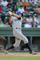 Right fielder Jordan Patterson (10) of the Asheville Tourists bats in a game against the Greenville Drive on Tuesday, July 1, 2014, at Fluor Field at the West End in Greenville, South Carolina. Asheville won, 5-2. (Tom Priddy/Four Seam Images)