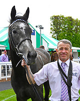 Winner of The Byerley Stud British EBF Fillies' Handicap Bella Vita and Lad in the Winners enclosure after winning The Byerley Stud British EBF Fillies' Handicap during Afternoon Racing at Salisbury Racecourse on 16th May 2019