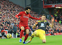 1st February 2020; Anfield, Liverpool, Merseyside, England; English Premier League Football, Liverpool versus Southampton; Mohammed Salah of Liverpool is tackled by Jan Bednarek of Southampton
