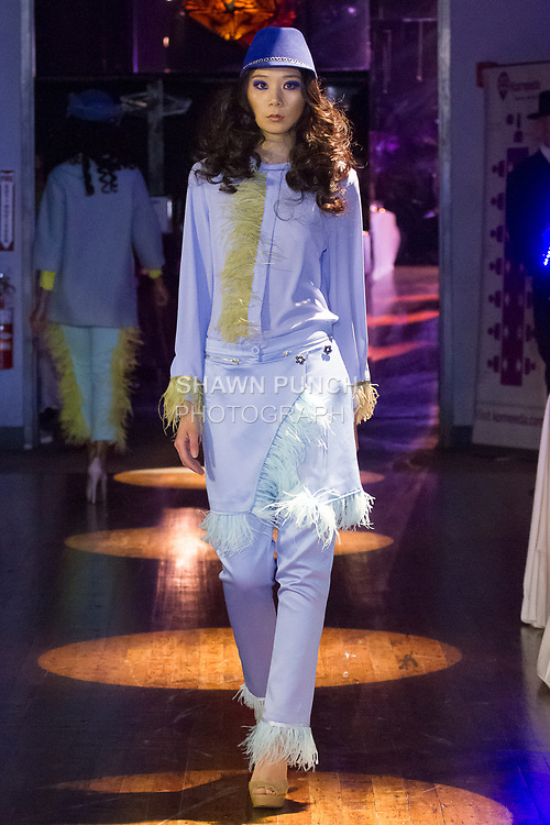 Model walks runway in an outfit from the Annie Couture Fall Winter 2017 collection by Anna Garbuzova, for the Dinner On The Runway event at Schimanski, on March 30, 2017, during Fashion Week Brooklyn Fall Winter 2017.