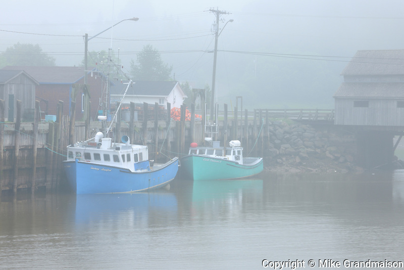 FIshing boats  in fog<br /> <br /> Saint Martins<br /> New Brunswick<br /> Canada