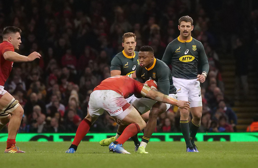 South Africa's Aphiwe Dyantyi is tackled by Wales' Ken Owens<br /> <br /> Photographer Ian Cook/CameraSport<br /> <br /> Under Armour Series Autumn Internationals - Wales v South Africa - Saturday 24th November 2018 - Principality Stadium - Cardiff<br /> <br /> World Copyright © 2018 CameraSport. All rights reserved. 43 Linden Ave. Countesthorpe. Leicester. England. LE8 5PG - Tel: +44 (0) 116 277 4147 - admin@camerasport.com - www.camerasport.com