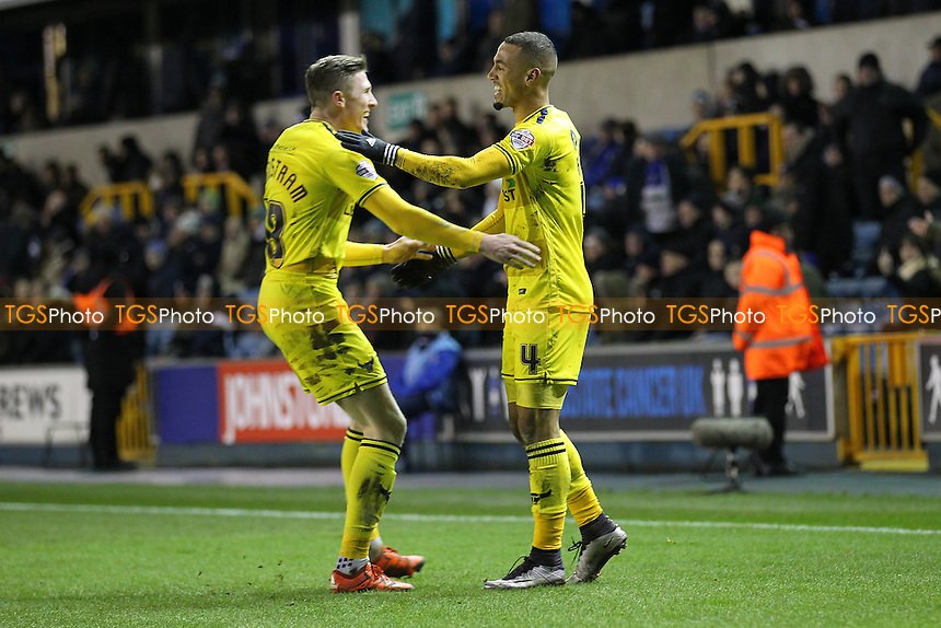 Kemar Roofe of Oxford United scores the second goal for his team and celebrates (R) during Millwall vs Oxford United at The Den