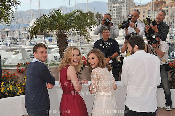 "LtoR: Brady Corbet & Louisa Krause & Elizabeth Olsen & director Sean Durkin at the photocall for their movie ""Martha Marcy May Marlene"" at the 64th Festival de Cannes..May 15, 2011  Cannes, France.Picture: Paul Smith / Featureflash"