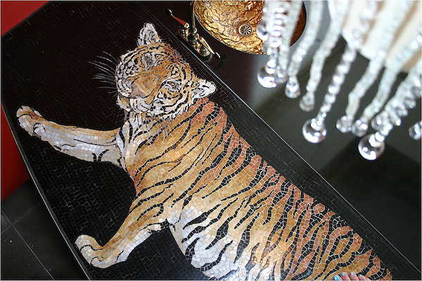 Custom Tiger stone mosaic bar top in Nero Marquina, Giallo Reale, Renaissance Bronze, Rosa Verona,Botticino, Crema Marfil honed and pillowed.
