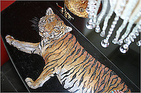 Custom Tiger stone mosaic bar top in Nero Marquina, Giallo Reale, Renaissance Bronze, Rosa Verona,Botticino, Crema Marfil honed and pillowed.