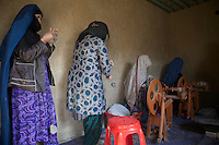 Afghan women spinning wool in Sahki-Abad village, project supported by the UN in North Afghanistan.