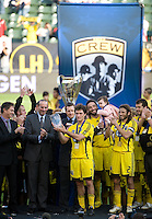 Don Garber presents Guillermo Barros Schelotto with the MVP trophy during MLS Cup 2008. Columbus Crew defeated the New York Red Bulls, 3-1, Sunday, November 23, 2008. Photo by John Todd/isiphotos.com