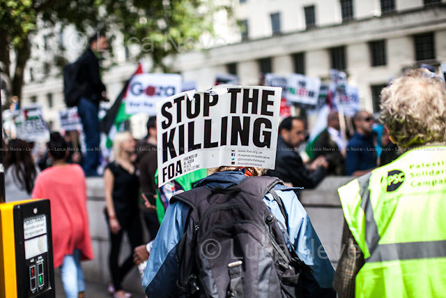 London, 23/08/2014. Hundreds of people gathered outside 10 Downing Street to call the British Government to stop all the arms related trade with Israel (<<which were worth £180m in the period 2008-2012 […] These equipment include F16 fighter jet components, assault rifles, armoured vehicles and ammunition […]>>, from the Friends of Al-Aqsa - FOA - online press release). The demonstration was organised by, amongst others, War On Want, Stop The War Coalition, London Palestine Action, FOA - Friends of Al Aqsa, PSC - Palestine Solidarity Campaign, BMI - British Muslim Initiative, Palestinian Forum in Britain, and Campaign for Nuclear Disarmament.