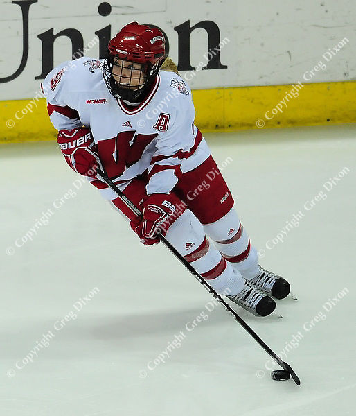Badger senior, Mallory Deluce, hits the puck, as the University of Wisconsin women's hockey team tops North Dakota 8-4 on Sunday, 2/13/11, at the Kohl Center in Madison, Wisconsin