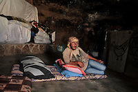 "Mohammed Jabareen, 25 is seen in the cave he lives with his family in Jenba a Palestinian town of 50 families seats in an area called by the IDF as ""Firing Zone 918"" and is located in the southern Hebron hills near the town of Yatta.  Spread over 30,000 dunams, it includes twelve Palestinian villages.  According to OCHA figures, 1,622 people lived in the area in 2010, and according to local residents the number of inhabitants currently stands at about 1,800. For over a decade, the residents of twelve uniquely traditional Palestinian villages in the area of Masafer-Yatta in the south Hebron hills have lived under the constant threat of demolition, evacuation, and dispossession.<br />