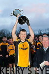 Luke Quinn captain of the Liebherr team lifts the cup after winning the All Ireland Senior A Inter firm final against reigning champions Medronic (Galway) in Fossa on Friday