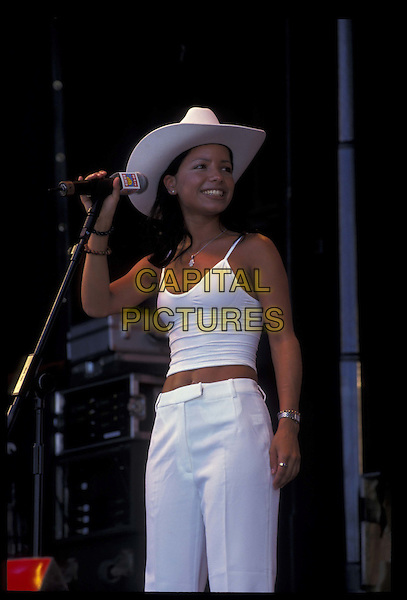 HONEYZ.24 July 1999.Ref: 8696.stage, live, concert, music, half length, half-length, hat.*RAW SCAN- photo will be adjusted for publication*.www.capitalpictures.com.sales@capitalpictures.com.©Capital Pictures