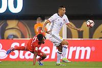 East Rutherford, NJ - Friday June 17, 2016: Renato Tapia, Edwin Cardona after a Copa America Centenario quarterfinal match between Peru (PER) vs Colombia (COL) at MetLife Stadium.