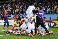 USA players pile on top of Landon Donovan to celebrate his game winning goal. USA defeated Algeria 1-0 in stoppage time in the 2010 FIFA World Cup at Loftus Versfeld Stadium in Pretoria, Sourth Africa, on June 23th, 2010.
