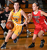 Helena Salmon #15 of Massapequa, left, gets pressured by Camryn Monfort #10 of Syosset during the Nassau County varsity girls basketball Class AA semifinals at LIU Post on Saturday, Feb. 25, 2017. Massapequa won by a score of 48-44.