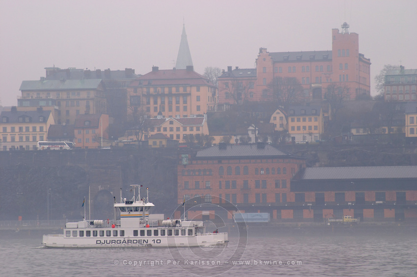 Djurgårdsbåt Djurgard boat for local traffic between Slussen and Djurgarden. Sodermalm in the background. Stockholm. Sweden, Europe.