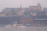 Djurgårdsbåt Djurgard boat for local traffic between Slussen and Djurgarden. Sodermalm in the background. Stockholm. Sweden, Europe.