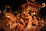 Naked men only with Fundoshi, Japanese traditional underwear, carry a potable shrine, mikoshi, to a shrine on the mountain crossing the river. Taketa. Japan.<br />