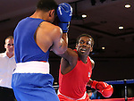 Derae Crane and Cam Awesome compete in the U.S. Olympic Boxing Trials in Reno, Nev., on Wednesday, Dec. 9, 2015. (AP Photo/Cathleen Allison)