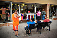 Shoppers hang out along Main Street in downtown McAllen, Texas, Sunday, April 4, 2010. Downtown McAllen stores don't sell designer or name brand items, but still reach a wide customer base for McAllen residents and visiting Mexican tourists. ..PHOTO/ Matt Nager