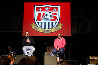 Marcelo Balboa answers questions from Allen Hopkins at the Paramount Theater in Denver, CO during the USA Men's National Team prep rally on March 21, 2013.