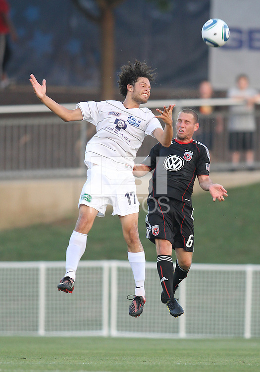 Kurt Morsink #6 of D.C. United goes for a header with Kai Kasiguran #17 of the Harrisburg City Islanders during a US Open Cup match at the Maryland Soccerplex on July 21 2010, in Boyds, Maryland. United won 2-0.