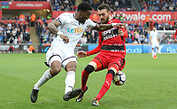 Leroy Fer of Swansea City back heels the ball between the legs of Scott Malone of Huddersfield Town during the Premier League match between Swansea City and Huddersfield Town at The Liberty Stadium, Swansea, Wales, UK. Saturday 14 October 2017