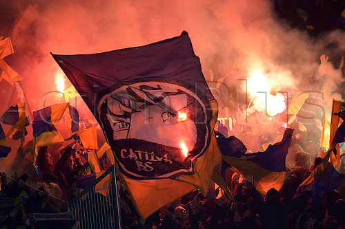 08.11.2013. Hanover, Germany.  Braunschweig fans light red flares in the stadium during the Bundesliga soccer match between Hannover 96 and Eintracht Braunschweig in Hanover,Germany, 08 November 2013.