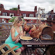 Re- Home Series. Devon, UK. 2010. Julia Stephenson, a 1990's 'It girl' and socialite turned 'Green Goddess'. Her rooftop in Kensington, London, now has a hen house where she keeps her ex-battery hens. Julia was worked as a 'green' columnist for a number of years for various newspapers and she also stood as a candidate for the Green Party. http://www.juliastephenson.net/