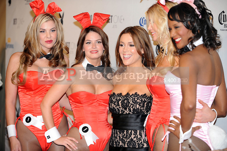 "Alyssa Milano poses with Playboy Playmates at Playboy's ninth annual ""Super Saturday Night""  party in at Playboy's Desert Oasis and Resort in Chandler, Arizona Saturday February 2, 2008.   (Photo by Alan Greth)"