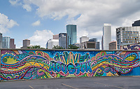This graffiti mural is located in downtown Houston with the city high rise buildings as a backdrop to this street art as some call it. We have more of these images in our Houston Lifestyles Street Scene sec.